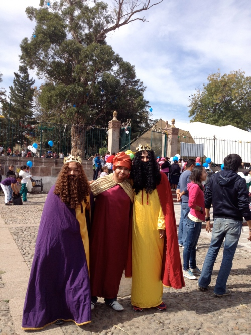 Co-workers dressed as the Three Wise Men